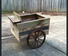 Made from pallets. Super cute. Could use it as a portable herb/vegetable patch