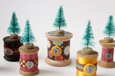 Making the most darling bottle brush tree Christmas decorations today. Combining diminutive trees with vintage spools of thread and a few embellishments.