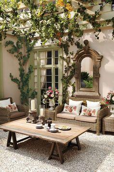 Cottage Patio with exterior stone floors, Laurel loveseat, Trellis, Sawhorse coffee table, Benson Sawhorse Coffee Table