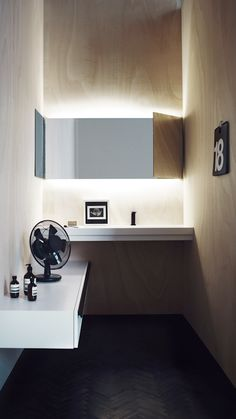 ... great lighting - Plywood bathroom - via cocolapinedesign.com