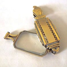 """A great gift for an opera lover. This art nouveau 18 karat gold lorgnette can be used as a pendant concealing a pair of reading glasses. The magnifying lenses measures 3-3/4"""" in length by 7/8"""" in width. Closed it measures 3"""" long by 7/8"""" wide. The entire piece weighs 18.8 dwt. Inscribed """"Betty"""" and """"1912-1937""""."""