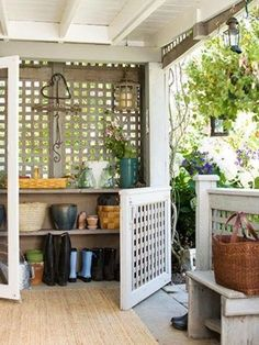 love this outdoor mudroom idea. Maybe an idea for out the back door - dog flap area.