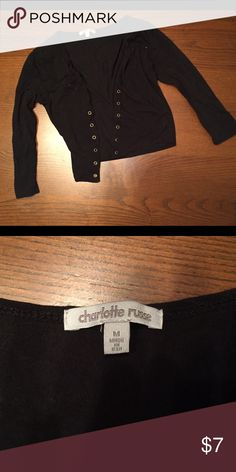 Black mid waist top with lacing Waist length black top, 3/4 sleeves and front lacing. Cord missing, but could easily be replaced. Good condition. Charlotte Russe Tops