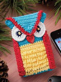 Woodsy Owl Phone Case Crochet Pattern Download from e-PatternsCentral.com -- This cute little guy would love to roost in your purse as a cellphone cozy!