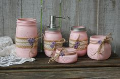 Shabby chic mason jar bathroom jar set. Hand painted in soft pink, wrapped with burlap, lace, tied with jute and dusty blue roses, finished with a protective coating. Metal soap dispenser, toothbrush