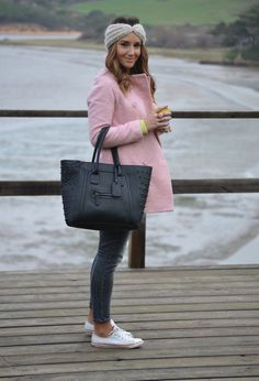 Shop this look on Lookastic:  http://lookastic.com/women/looks/headband-coat-crew-neck-sweater-tote-bag-skinny-jeans-low-top-sneakers/8428  — Grey Knit Headband  — Pink Coat  — Yellow Crew-neck Sweater  — Black Leather Tote Bag  — Charcoal Skinny Jeans  — White Canvas Low Top Sneakers
