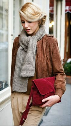 Play with texture.I love the relaxed depth this outfit offers. Between the suede bag, leather jacket, and the knit scarf, it's a stylishly understated look that's perfect for work or play.