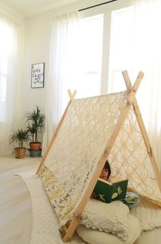 wanderlustmusings:  diy frame tent from the lovelies at a beautiful mess  The linked tutorial actually advises using a vintage crochet cover...