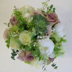 "A beautifully subtle Bridal bouquet in shades of Pale Green, Ivory and Mushroom Shades White Peonies, fresh Fragrant Lily of the Valley, ""G. Floral Bouquets, Wedding Bouquets, Floral Wreath, Vintage Wedding Flowers, Floral Wedding, Celebrate Good Times, Flower Designs, Flower Ideas, White Peonies"