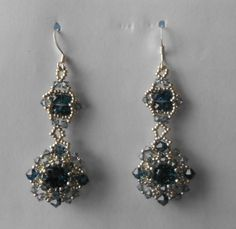 I made these earrings for a Christmas earring exchange on the Auntie's Beads Facebook page. I used Sidonia's 'Sweet Romance' pattern and re-created both motifs to make the earrings. The only change I made is using 4mm bicones in the smaller motifs instead of 3mm. I liked the way the 4mm filled up the space.