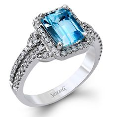 Brides.com: Engagement Rings with Colored Stones. Style TR148, 18K white gold ring with .42ctw round white diamonds and a 1.31ctw aqua center, $4,180, Simon G  See more Simon G engagement rings.