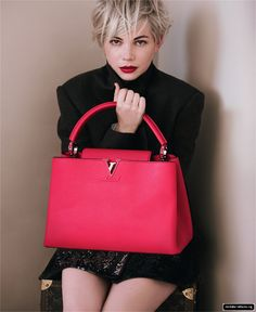 OBSESSED. Michelle Williams for Louis Vuitton Fall/Winter 2013/2014. Hot pink Louis Vuitton handbag.
