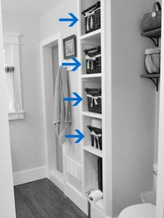 Open-concept Linen Closet.  What a great idea for ours - the doors have fallen off due to foundation issues.  I currently use a curtain to cover it, but I love this idea!