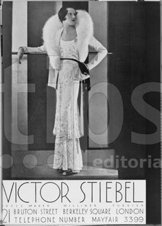 A model wearing a bias cut slimline white devore evening gown complete with a matching jacket with huge fur collar featured in an advert for the couture house Victor Stiebel. Date: March 1932
