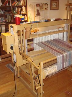 Computer controlled multi-harness loom.