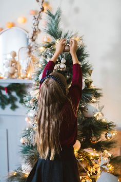 Pretty Girl Decorating Christmas Tree by Lumina - Stocksy United Christmas Tree Trimming, Christmas Trimmings, Xmas Tree, Christmas Tree Decorations, Christmas Feeling, Christmas Love, Christmas Colors, Christmas And New Year, Christmas Child