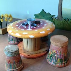Table and chairs made from spool and planters. Saw it at Phoenix Children's Museum