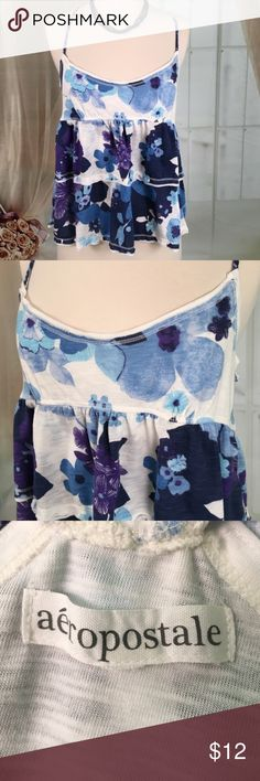 Aeropostale Blue Floral Summer Crop Top Super cute blue floral summer crop top by Aeropostale. 60% cotton and 40% polyester. Great condition. Size L. Bust measured flat armpit to armpit 16 inches length 24 inches. Note: necklace not included. TP10 LOC-8 Aeropostale Tops Crop Tops