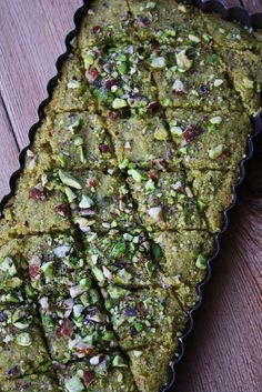 Pistachio Basboussa Recipe - an Egyptian dessert.It is known in neighboring countries as hareesa/hareeseh or namoura and in Greece and Turkey as revani. Egyptian Desserts, Egyptian Food, Moroccan Desserts, Egyptian Recipes, Chocolate Baklava, Pistacia Vera, Arabic Food, Arabic Sweets, Ramadan Sweets