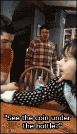 See the coin under the bottle? #gif