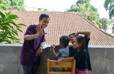 Volunteer coordinator Eka translating for the kids the exercise.