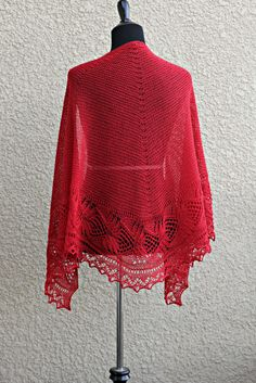 Knit shawl with laced border in red color