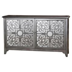Perfect for displaying a lush floral arrangement or stowing board games and DVDs, this handsome sideboard showcases fretwork details and a painted metallic f...