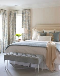 Idea for master bedroom. I like the pop of color on the white (pale blue/cream pillows in front of the large white pillows, and pale blue blanket on the white duvet cover).