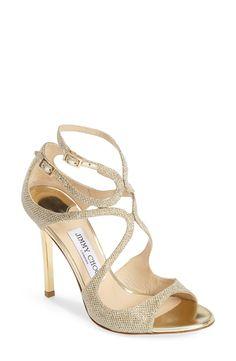 Stunning glittering gold Jimmy Choo sandals.