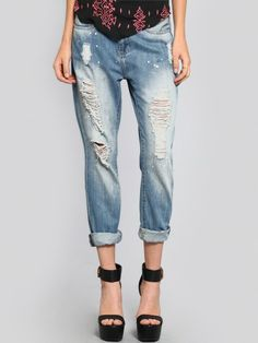 Light wash, straight leg boyfriend jeans featuring rips, fading and white paint splatters with 5 pocket styling and a zip fly closure