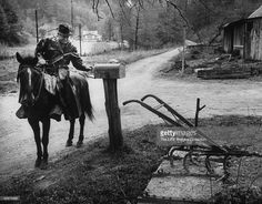 Rural postman delivering mail on mule, in back woods section of Kentucky. Get premium, high resolution news photos at Getty Images Us Postal Service, United States Postal Service, Old Pictures, Old Photos, Vintage Photographs, Vintage Photos, Going Postal, Old Florida, Vintage Pictures