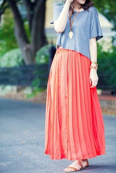 long skirt, boxy top, and leaf necklace....