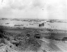 High concentration of boats and vehicles from the top of Omaha Beach. The view is from the top of Wn 61A Colleville-sur-Mer. From before the storm of 19-21 June 1944. A LST is beached to unload its cargo of vehicles through its front door. # WWII # War-21 juin 1944. Un LST est échoué sur la plage pour y débarquer son chargement de véhicules par sa porte avant. #WWII #War