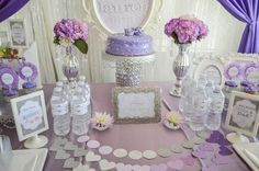 Lovely dessert table at a purple and silver baby shower! See more party planning ideas at CatchMyParty.com!