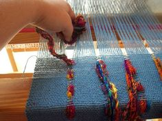 during weaving -- after each 6 picks of plain weave -- bundles of 4 strands of recycled silk yarn are inserted into the spaced warp | the recycled silk yarn is delicate & irregular, unsuitable as warp; hence, the need for inserting multiple strands by hand