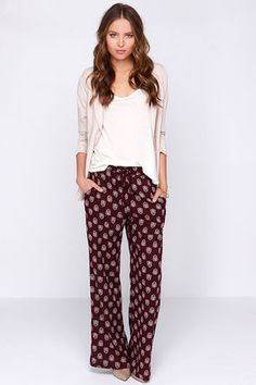 Whether you're a professional yogi or certified lounger, the Lucy Love Chakra Burgundy Print Pants will have you experiencing the best in chic comfort! These cozy apartment pants are made from a soft woven fabric in a rich burgundy (with plum purple undertones) covered in an exotic ivory print. An elasticized, drawstring waist allows for these pants to be worn high on the waist, or low on the hips for a casual look worthy of any laid-back weekend. Front diagonal pockets. Wide cut legs…