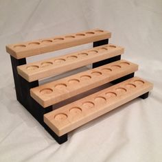 This hand crafted wooden essential oil storage shelf is designed to sit on your table or dresser. It features 32 depressions sized to fit 5ml