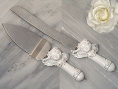 We all want a piece of cake, everyone enjoys the special moment of watching the bride and groom cutting their wedding cake. We have the perfect accessory for that wonderful tradition. Each of these sturdy stainless steel cake and knife servers are accented with sculpted cherub design highlighted with perfectly placed crystal accents.    #timelesstreasure