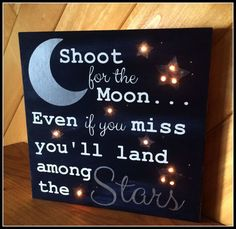 Shoot for the moon. Even if you miss you'll land among the Stars… Wood canvas sign, with twinkle lights! Product Description: • Pictured… is