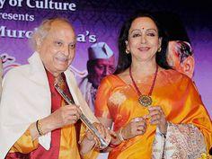 Hema Malini felicitating Pandit Jasraj