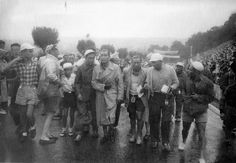 I love this photo so much, Gino Bartali, his team and team mates are on their way to complain about his treatment by fans during the 1950 TdF. Whilst in the Pyrenees Gino was kicked and punched by French spectators during the ascent of the Col d' Aspin. All the Italian teams withdrew from the race in protest to the way Gino was treated. The faces in this photograph look like they are walking from a war field rather than a bicycle race.