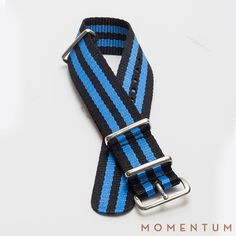 Blue and black striped nato available in steel buckle: http://momentum-dubai.com/collections/watch-straps/products/watch-strap-nato-blue-black-double-striped