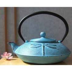 Got this thing with traditional Japanese tetsubins - cast iron teapots. Love this one with its dragonfly.