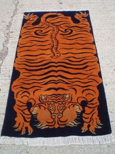 Weird Rugs tufted tiger rug- this is a great copy/alternative if you can't