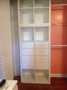 Master closet: IKEA Kallax shelving. Wall color Citrus Hill by Behr.