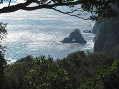"The rock with the hole in it is called ""Tori Iwa."" It sits at the base of the Senba sea cliffs on Shikoku's east coast. Photo taken from a rest pavilion on the Hiwasa Coastal trail, part of the ""Shikoku no michi."""