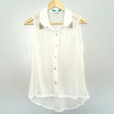 White Sheer Sleeveless Top Junior size. Excellent condition. 100% polyester. Studded detail on collar. Ready for shipping. Thank you for shopping my closet ! Xoxo Tops Button Down Shirts