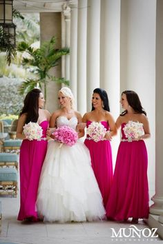 Like the white bouquets for bridesmaids against the dresses and the fuscia bouquet against the wedding dress