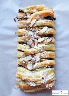 Easy Puff Pastry Dessert or Breakfast. Warm gooey chocolate baked inside of a tasty crescent puff pastry. Delicious almond topped chocolate braid recipe for brunch, breakfast, or school party. Easy Puff Pastry Desserts, Puff Pastry Recipes, Köstliche Desserts, Savory Pastry, Pizza Pastry, Pastries Recipes, Dessert Recipes, Puff Recipe, Chocolate Pastry