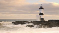 lighthouse on a rough shore in wales - waves, lighthouse, rocks, cost